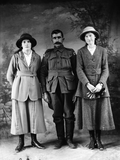 Two women and soldier