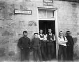 Group of men outside Hamnavoe Post Office