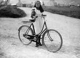 Girl with pushbike at Stove