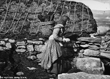 Woman with a kishie of peats