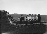 Group seated on wall head of the Broch of Mousa
