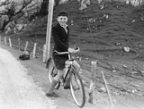 Joe Mouat on bicycle