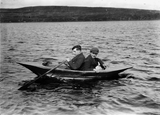 Two men in canvas boat