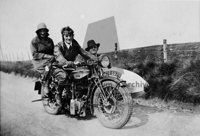 People on motorcycle and sidecar